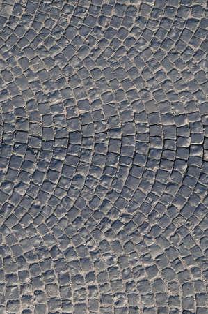 firmeza: Parte adoquines de una calle del pueblo pavimentado con adoquines