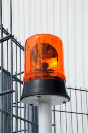 Flashing light  Photo of a round flashing light in front of an iron fence Stock Photo - 11010944