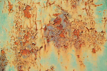 Rusty background        A rusty old metal plate in different colors photo