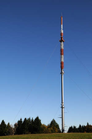 Radio mast A radio mast on a hill under a blue sky Stock Photo - 11139626