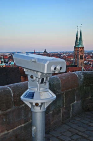 Nuremberg view point Viewpoint with spyglass overlooking the old historic centre of Nuremberg in Germany with the church Saint Sebald photo
