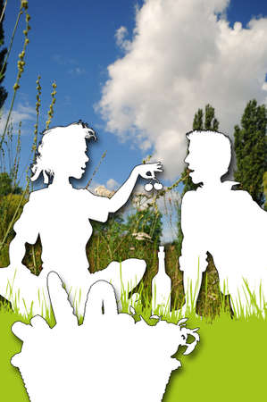 Picnic Silhouettes of a young couple sitting in a meadow on a picnic photo