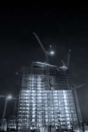 Big construction site A big construction site with cranes by night photo