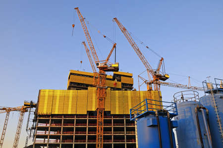 counterweight: Big construction site A big construction site with cranes and silos Stock Photo