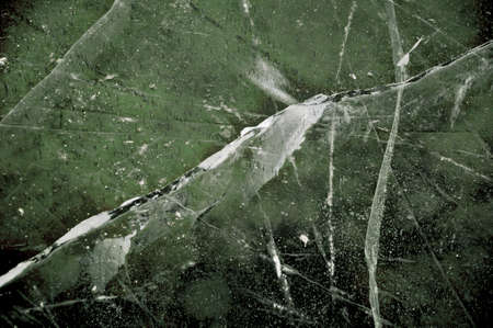 Cracked ice Detail of a frozen river with cracked ice photo