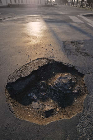 Pothole Photo of a dangerous pothole on a road  photo
