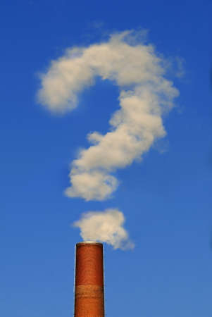 Factory chimney Part of a factory chimney with rising smoke in form of a question mark under a blue sky photo
