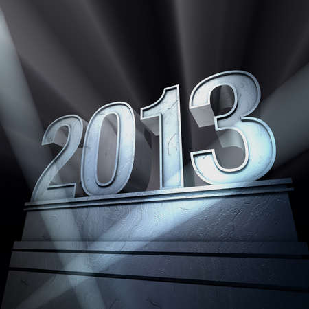 Year 2013  Number 2013 on a silvery pedestal at a black background             photo
