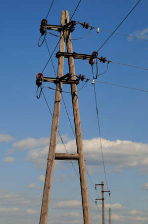 outdoor electricity: Electric power poles Old wooden electric power poles and power lines