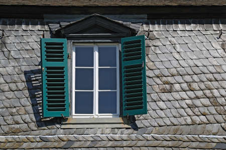 Attic window A tiled roof with a closed attic window  Stock Photo - 16598120