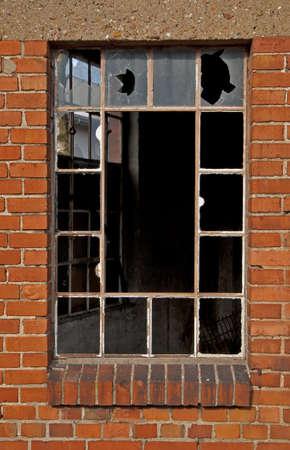 deletion: Window Broken at to Industrial Building Facade Stock Photo