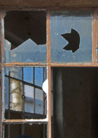 transom: Window Broken at to Industrial Building Facade Stock Photo