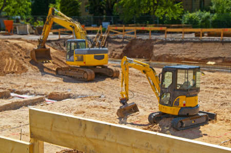 Construction site foundation with excavator photo
