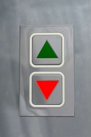 command button: Elevator information plate in upward position with a shining red pilot lamp