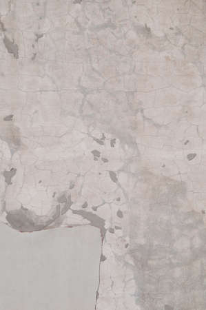 the trappings: Eroded old plaster at a wall texture