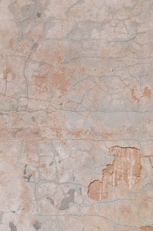 tainted: Eroded old plaster at a wall texture