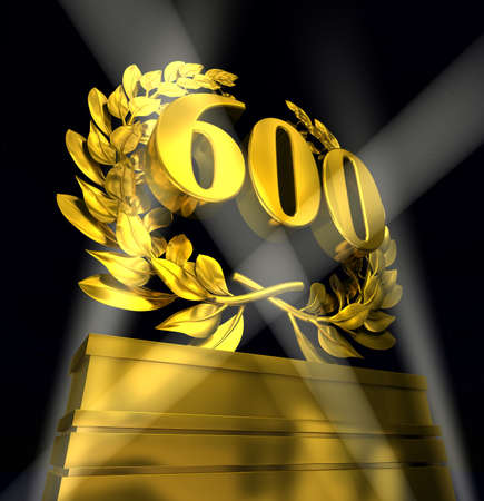 commemoration day: 600 sixhundred number in golden letters at a pedestrial with laurel wreath on black background
