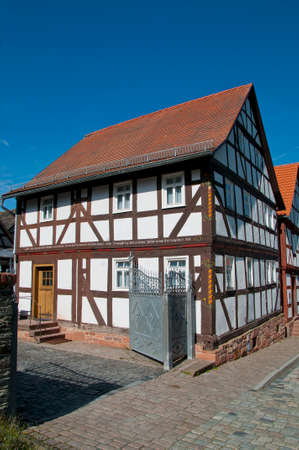 constancy: Halftimbered House Street in a landscape