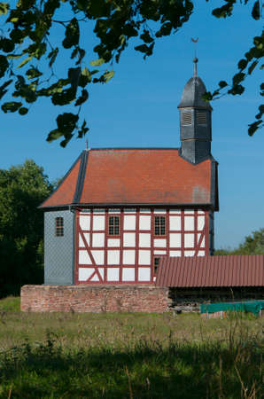 constancy: Halftimbered church in a landscape Museum