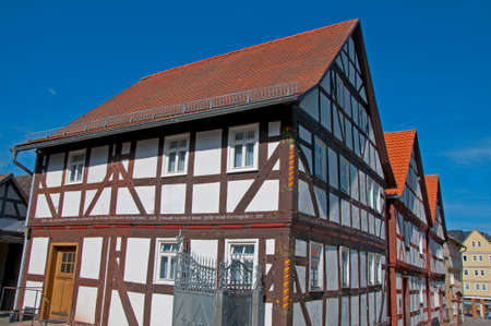 permanence: Halftimbered House Street in a landscape