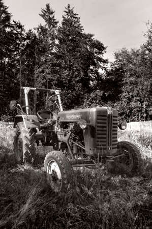 old tractors: tractor old in field in black and white
