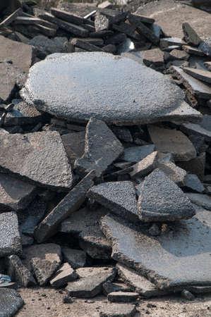 Asphalt recycling broken pieces heaped