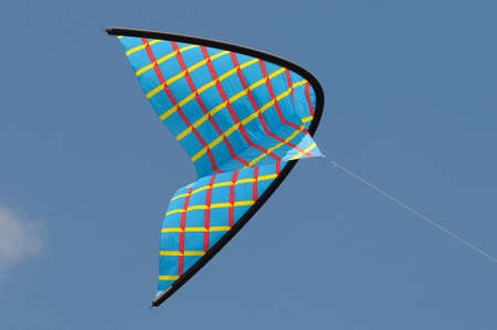 kiting: Abstract colorfull kite in a blue sky