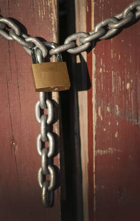 pivot: lock and chain at wooden fence
