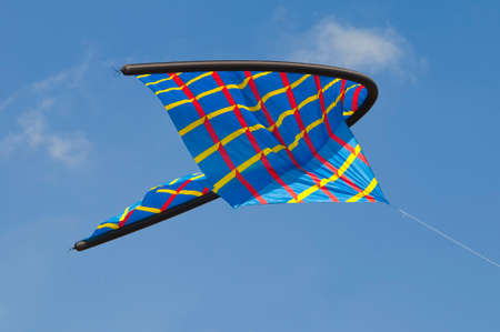 freetime activity: Abstract colorfull kite in a blue sky