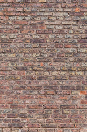 Wall of old burnt bricks texture
