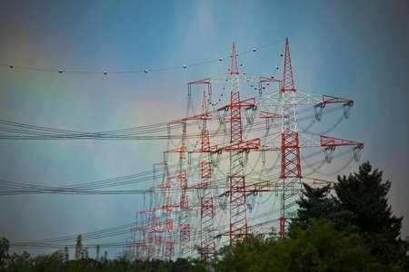 electrochemical: Electrical tower painted in red and white with rainbow