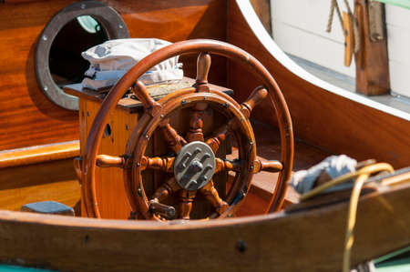 Single wooden steering wheel at an ancient sailing boat