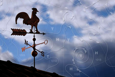 weather map: Weathercock with weather map in background Stock Photo