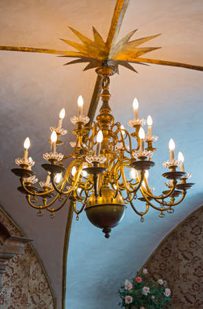 chrom: Candelabrium ancient in an old manor house Stock Photo