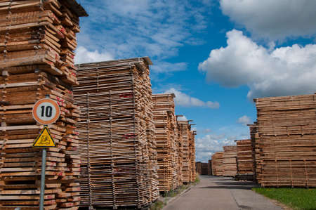 Lumber yard, with stack of wooden boards Stock Photo