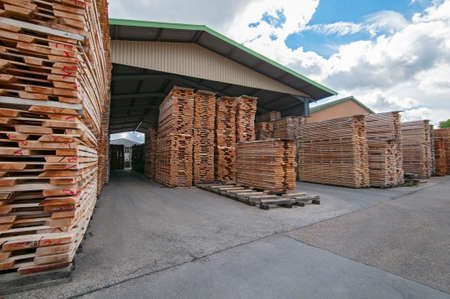 Lumber mill with stack of boards Stock Photo