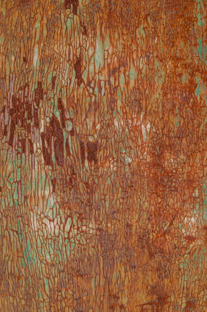 gloss: Weathered once painted metal surface with lot of rust Stock Photo