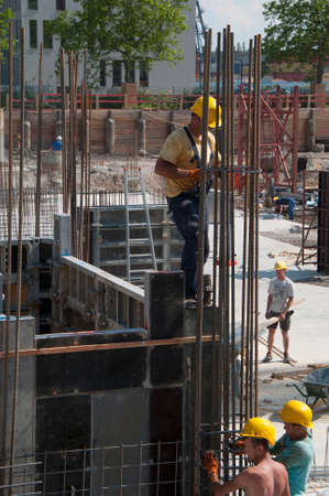 construction site, workers with reinforcement construction