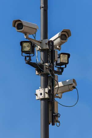 Surveillance camera under a blue sky Stock Photo