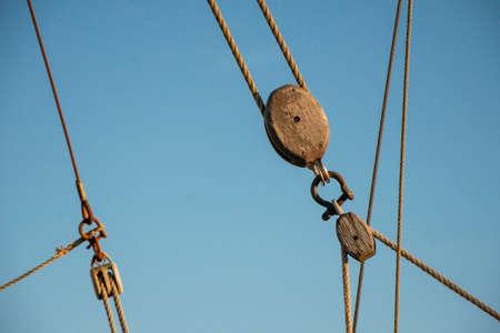 weathered pulley and ropes at a sailingship