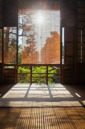 house with style: silhouette photo of windows frame in old Japanese style house with direct sun