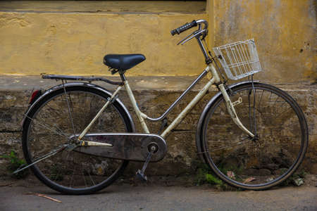 Bicycle and old house in Hoi an, Vietnam photo
