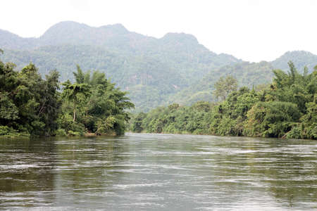 River and a hill at the jungle photo