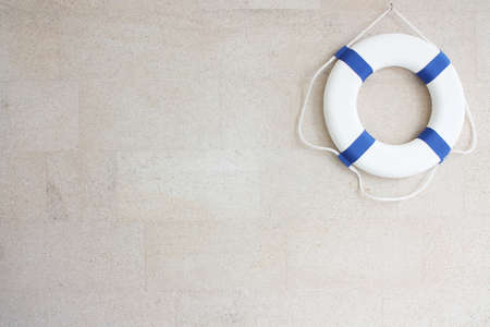 buoy: White and blue lifebuoy on  wall  Stock Photo