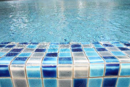 Edge of swimming pool photo