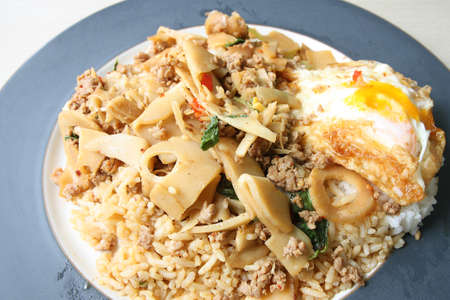 Fried rice with bamboo shoots, basil and egg  photo