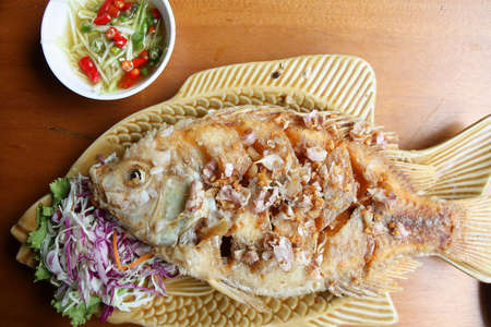 Fried fish with garlic  photo