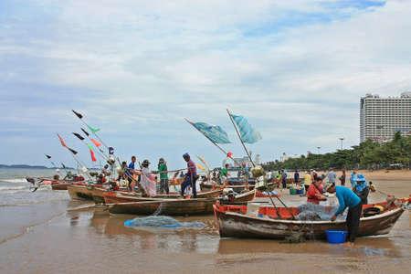 Pattaya beach,Thailand fishermen pack fishing net  Stock Photo - 15347170