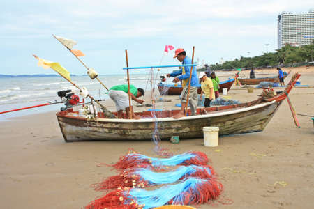 Pattaya beach,Thailand fishermen pack fishing net Stock Photo - 15347171