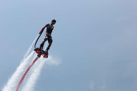 jet skier: the ship flyboard acrobatics, November 24 2012 at the boat show  Ocean Marina in Pattaya, Thailand  Editorial